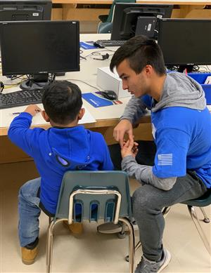 Mentor and Student Working at Computer